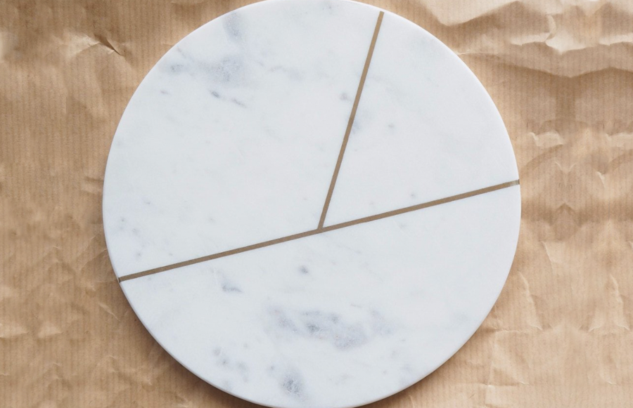 Marble slab with geometric detail. Use as a luxurious serving slab and style your food around the striking gold design element.