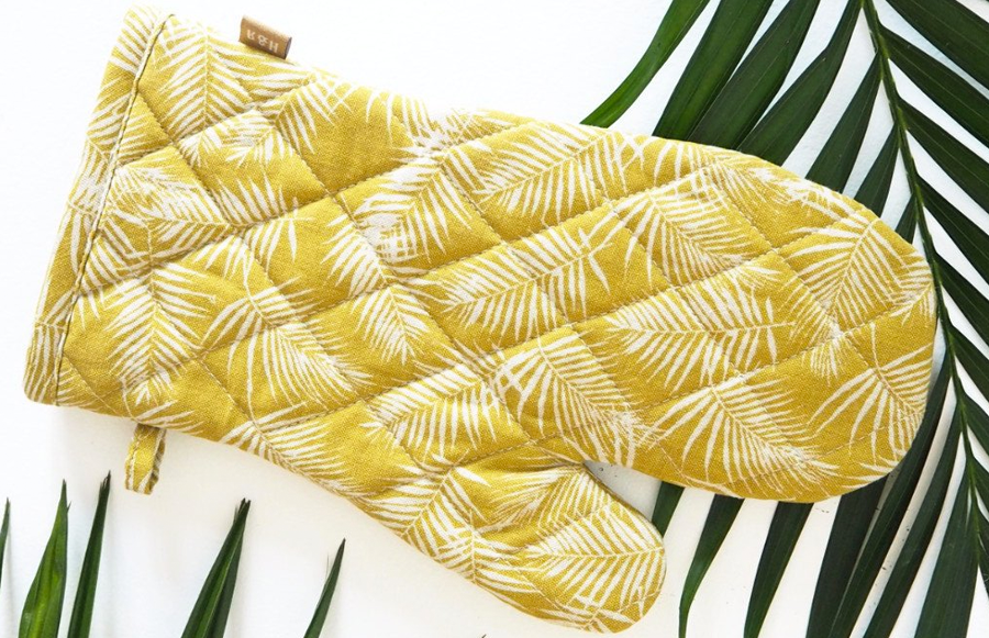 This handmade quilted oven glove comes in a gorgeous golden palm leaf print.